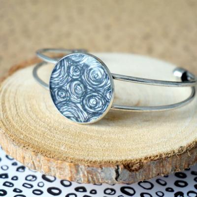 Bracelet argente noir blanc spirales finement paillette